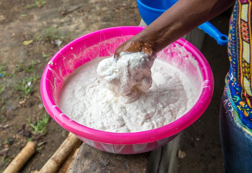 A woman stirs a Cassava (Manihot esculenta) based FuFu dough in Ganta, Liberia