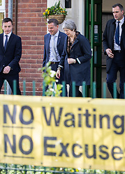 © Licensed to London News Pictures . 30/04/2018. Manchester , UK. British Prime Minister THERESA MAY (c) leaves Brooklands Primary School in Sale after a visit , accompanied by Trafford Council leader SEAN ANSTEE (l) and head master MATTHEW COPPING (2nd left) . May is facing questions over her role in the scandal of the way Windrush migrants have been treated and after the resignation of Home Secretary, Amber Rudd, late last night (29 April 2018) . Photo credit : Joel Goodman/LNP