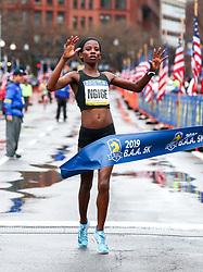 Monicah Ngige of Kenya wins the women's BAA 5K in 15:16