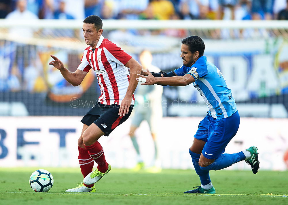 "MALAGA, SPAIN - SEPTEMBER 23:   Mikel Vesga of Athletic Club (L) being followed by Jose Luis Garcia ""Recio"" of Malaga CF  (R) during the La Liga match between Malaga and Athletic Club at Estadio La Rosaleda on September 23, 2017 in Malaga, .  (Photo by Aitor Alcalde Colomer/Getty Images)"