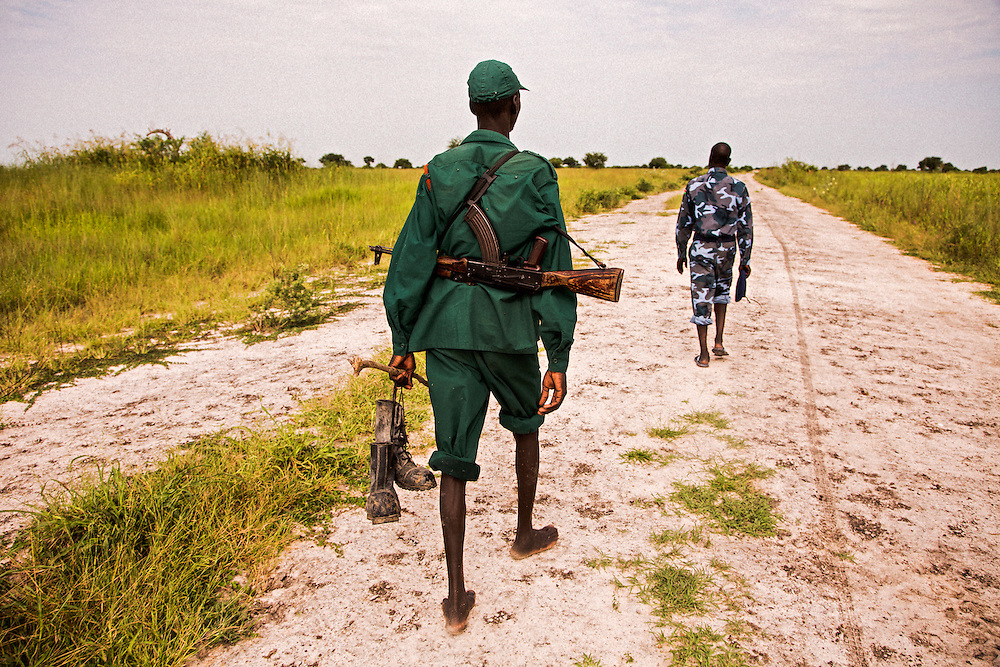 Soldiers leading an expedition from Panyagor 9km out along impassible dirt road to view the Jonglei canal.