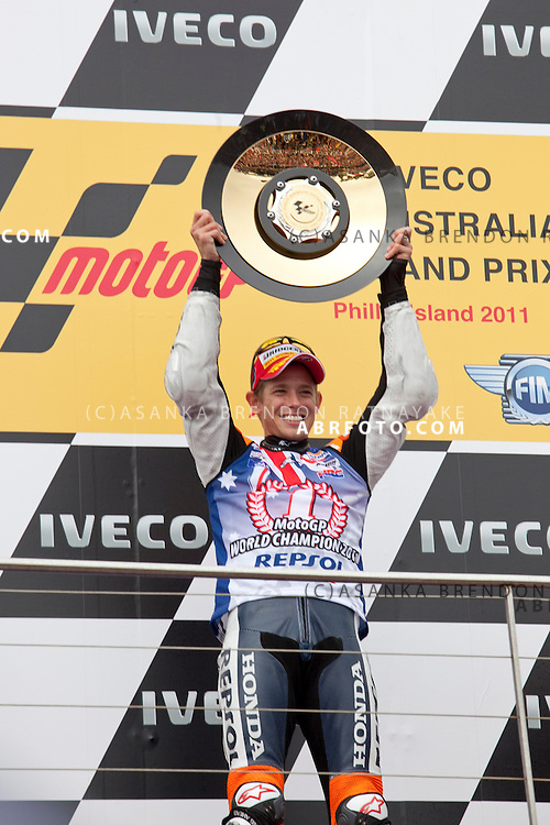 16 October 2011: Race winner & newly crowned 2011 World Champion Australian Casey Stoner lifts his trophy in front of his home fans at the completion of the IVECO Australian MotoGP Grand Prix at the Phillip Island Circuit in Phillip Island, Victoria, Australia.
