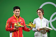 RIO DE JANEIRO, BRAZIL - AUGUST 15: China\'s Lyu Xiaojun, silver medalist of the Men\'s 77kg Group A weightlifting, exchanges gifts with the Olympic Organizing Committee on Day 10 of the Rio 2016 Olympic Games on August 15, 2016 in Rio de Janeiro, Brazil.<br /> ©Exclusivepix Media