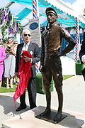 The great Lester Piggott unveils a life size bronze statue by sculptor William Newton outside the Edwardian Weighing Room  during the Ebor Festival at York Racecourse, York, United Kingdom on 21 August 2019.