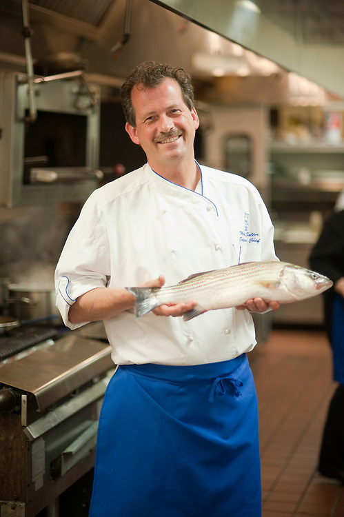 Chef holding a fish in the kitchen
