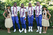 KO OLINA - FEBRUARY 11:  NFC Green Bay Packers 2005 NFL Pro Bowl All-Stars (players left to right: Javon Walker #84, Ahman Green #30, William Henderson #33, Marco Rivera #62) pose with Hawaiian Hula girls for their 2005 NFL Pro Bowl team photo on February 11, 2005 in Ko Olina, Hawaii. ©Paul Anthony Spinelli