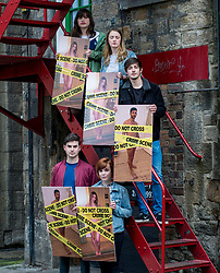 Young campaigners hold giant photos covered in crime scene tape to highlight the introduction from today of the Abusive Behavior and Sexual Harm (Scotland) Act 2016, which now makes it a criminal offence to post so caled 'revenge porn' pictures on social media.<br /> <br /> &copy; Dave Johnston/ EEm