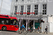 "The UK government has announced a Coronavirus pandemic financial rescue package for the Arts industry, a £1.15bn support for cultural organisations in England which is made up of £880m in grants and £270m of repayable loans. But venues such as The Old Vic theatre in Waterloo will remain for the foreseeable future, on 6th July 2020, in London, England. Some theatres in London and others around the country have been wrapped in bright pink barrier tape, which reads ""Missing Live Theatre"" -  a protest project led by stage designers group Scene Change. The arts and culture arts industry supports 137,250 jobs and is worth £21.2bn in direct turnover."