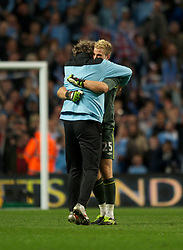 MANCHESTER, ENGLAND - Monday, April 30, 2012: Manchester City's Gael Clichy celebares at full-time with a member of the coaching staff following the Premiership match at the City of Manchester Stadium. (Pic by Chris Brunskill/Propaganda)