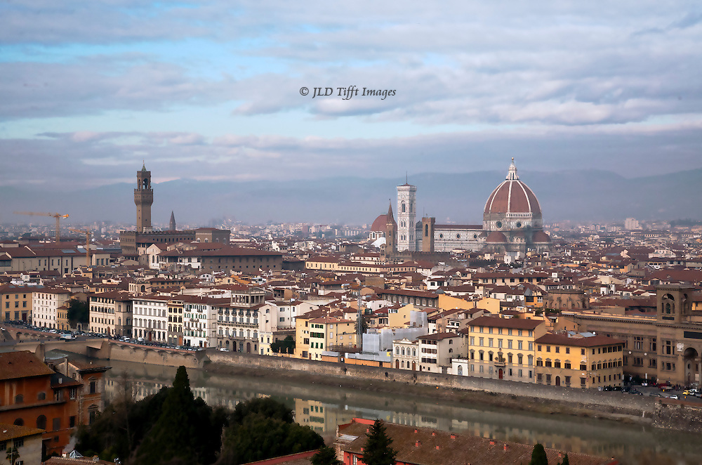There are many postcard views of Florence and the Duomo, so it's not easy to be different.  One of the standard viewpoints is from the Piazzale Michelangelo, a hub for tourists, buses, and souvenir sellers.  The Duomo, Campanile, Baptistry, and Palazzo Vecchio are all visible.