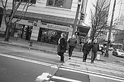 2017 MARCH 05 - Pedestrians cross 3rd Ave at Union Street downtown, Seattle, WA, USA. By Richard Walker