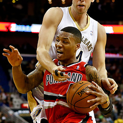 Dec 30, 2013; New Orleans, LA, USA; Portland Trail Blazers point guard Damian Lillard (0) drives past New Orleans Pelicans center Greg Stiemsma (34) during the second half of a game at the New Orleans Arena. The Pelicans defeated the Trail Blazers 110-108. Mandatory Credit: Derick E. Hingle-USA TODAY Sports