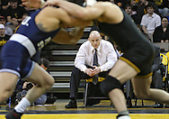 January 29, 2010: Penn State head coach Cael Sanderson watches Penn State's Frank Molinaro and Iowa's Brent Metcalf in the 149-pound bout at Carver-Hawkeye Arena in Iowa City, Iowa on January 29, 2010. Metcalf pinned Molinaro in 3:56 and Iowa defeated Penn State 29-6.