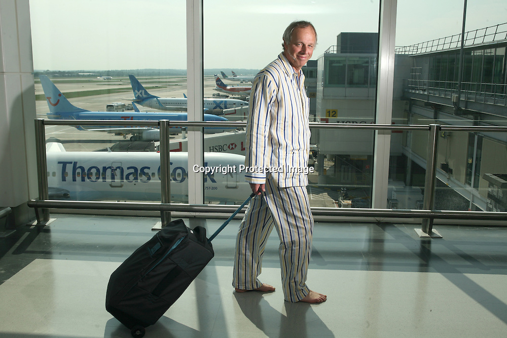 Launch of Yo!tel in Gatwick airport. Simon Woodroffe in pyjamas heading to Yo!tel Gatwick.
