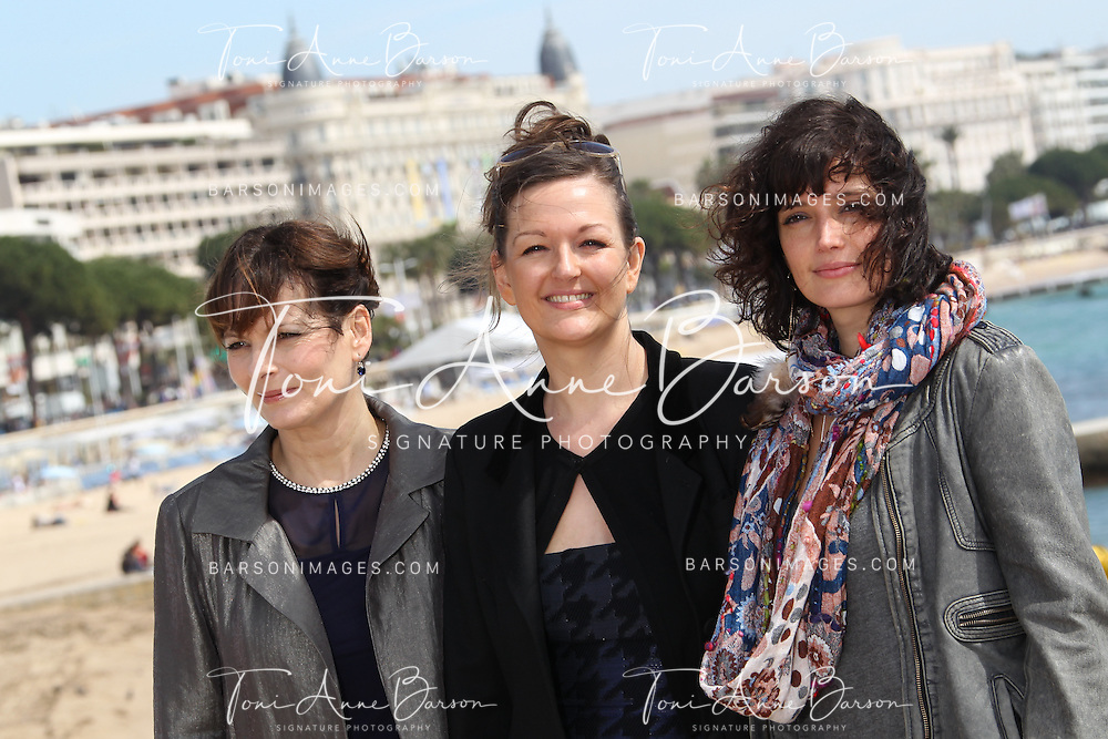 """CANNES, FRANCE - APRIL 09:  Cecilia Hornus, Anne Girouard and Helene Seuzaret attend """"Marseille' Photocall  on April 9, 2013 in Cannes, France.  (Photo by Tony Barson/Getty Images)"""