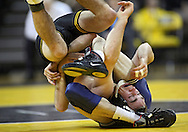 January 29, 2010: Iowa's Daniel Dennis finds himself in an awkward position as he wrestles Penn State's Bryan Pearsall in the 133-pound bout at Carver-Hawkeye Arena in Iowa City, Iowa on January 29, 2010. Dennis won the match 17-7 and Iowa defeated Penn State 29-6.