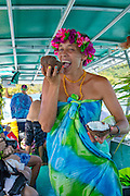 Opening Coconut, boat tour, Huahine, French Polynesia