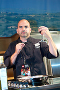 """Chef J. Geoffery Johnson, executive chef at Copper Fish in Cape May, NJ demonstrates during the Atlantic City Food & Wine Festival. Assisting Chef Johnson is Rocky Fino, author of the cookbook """"Will Cook For Sex."""""""