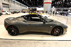 "12 February 2015:   2015 LOTUS EVORA IPS 2+2: Get your camera ready for the exotic vehicles in the Super Car Gallery exhibit at the Chicago Auto Show (Feb.14-22, 2015). This includes the exotic Lotus Evora IPS 2+2 sports car. ""Wowing"" the show goers with its swept-forward cabin and aggressive poise, the Evora models come fitted with a mid-mounted 3.5-liter V-6, rear-wheel drive and weighing in at a mere 3,000 pounds. The stock engine develops 276-horsepower/258 lb. ft. of torque, and for more attitude, the supercharged Evora S delivers 345hp and 295lb. ft. of torque with a 0-to-60mph time of 5.0 seconds and a governed 159 mph top speed.  Buyers can select a six-speed manual gearbox or six-speed automatic transmission, as well as 18- or 19-inch alloy rims framed by Pirelli P-Zero tires. In fluctuating traffic conditions the 'IPS' (Intelligent Precision Shift) automatic version with paddle shift control provides a more relaxed driving mode thanks to its flowing power delivery. The Evora chassis is composed of an extruded and bonded aluminum structured developed for its lightweight yet incredibly stiff design. Surprisingly, there is a combined 23.0 cu. ft. of cargo space behind the front seat and trunk. For 2015, the Evora is a Lotus created to take you further, for longer, and in greater comfort than ever before. Once behind the wheel of the Evora, the ""so many roads, so little time"" Lotus tagline becomes quite evident.<br /> <br /> First staged in 1901, the Chicago Auto Show is the largest auto show in North America and has been held more times than any other auto exposition on the continent. The 2015 show marks the 107th edition of the Chicago Auto Show. It has been  presented by the Chicago Automobile Trade Association (CATA) since 1935.  It is held at McCormick Place, Chicago Illinois"