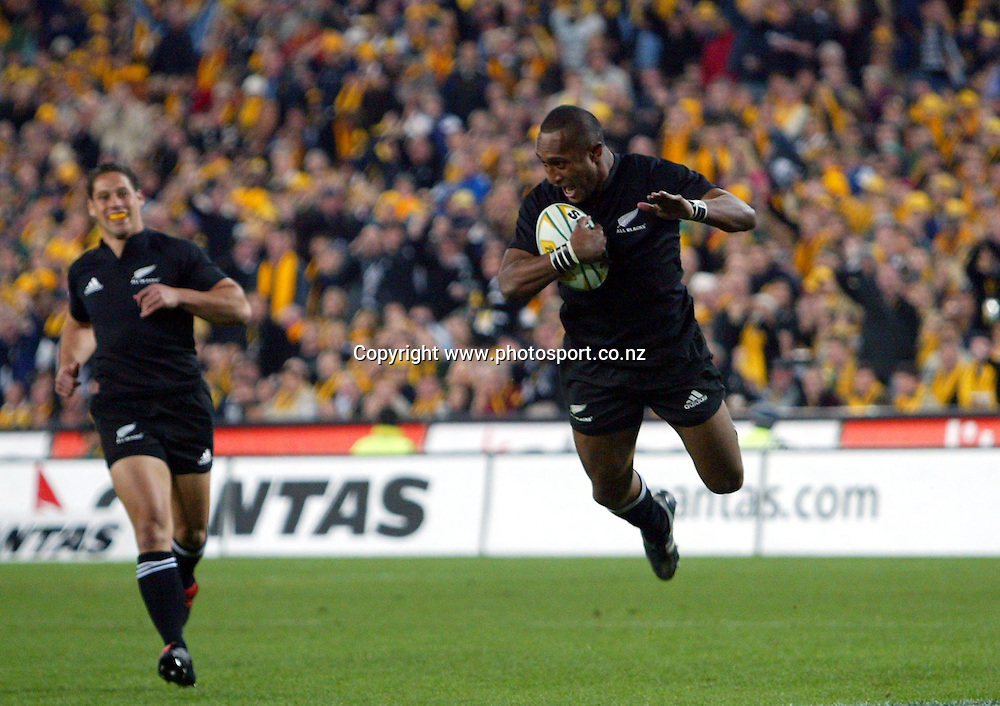Joe Rokocoko dives into score during the Bledisloe Cup match between the All Blacks and the Wallabies at Telstra Stadium, Sydney, Australia on Saturday 13 August, 2005. The All Blacks won the match 30 - 13. Photo: Hannah Johnston/PHOTOSPORT<br />