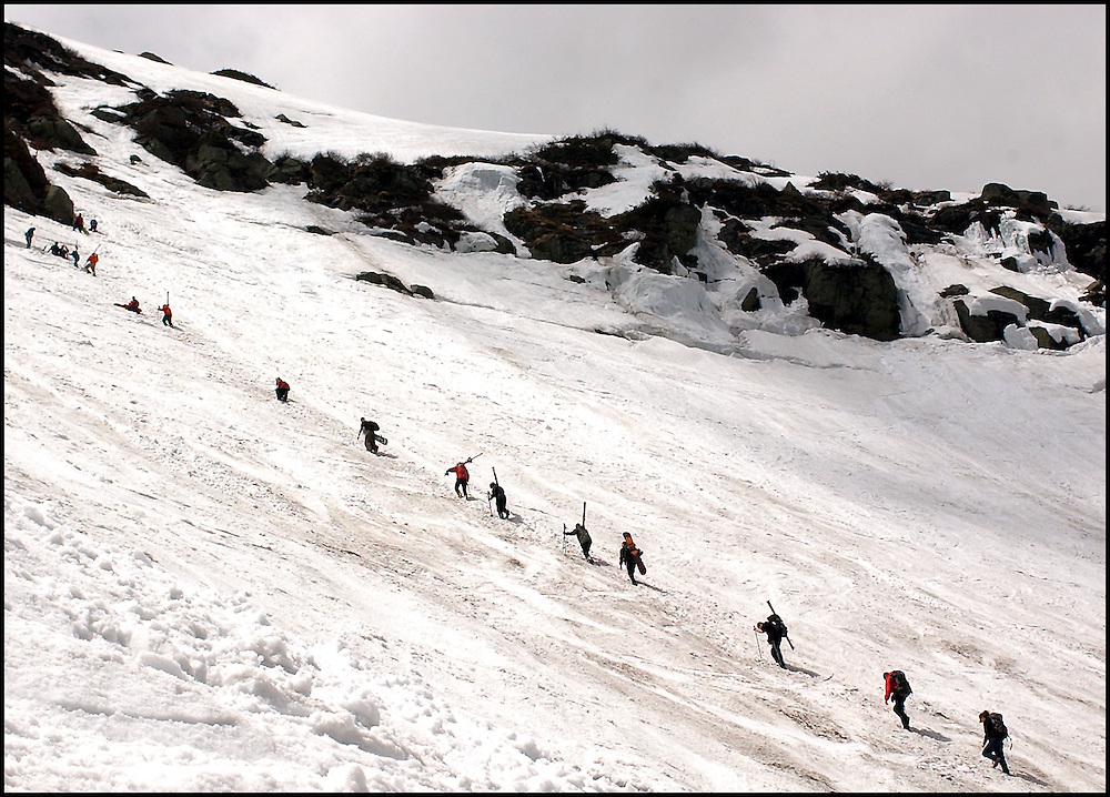 (5/10/03 Mt. Washington, NH) Skiers stream up the mountain as they take advantage of spring conditions at Tuckerman's Ravine. (051003tuckmjs-staff photo  by Michael Seamans. Saved in photo Adv. Sports/cd.)
