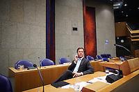 Nederland. Den Haag, 19 mei 2011.<br /> Minister-president Mark Rutte belt voor hervatting van het debat in vak K.<br /> Verantwoordingsdag. Debat in de Tweede Kamer. Het kabinet legde tijdens dit debat verantwoording af over het gevoerde beleid tegenover de fractievoorzitters.<br /> Foto : Martijn Beekman