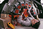 Physics: Geneva, Switzerland. CERN: L-3 Experiment. A technician (K. Reismann) works inside the L3 detector at CERN, the European centre for particle physics near Geneva. The L-3 experiment is part of CERN's Large Electron- Positron Collider (LEP), inaugurated on 13 November 1989. L3 is one of 4 giant particle detectors at the LEP Collider. LEP collides electrons & positrons accelerated to an energy of 50 GeV in a circular tunnel 100m underground & 27km in circumference. L3 is a cylindrical assembly of many types of apparatus - hadron & electromagnetic calorimeters, drift chambers, & a time projection chamber - which fit together, like layers of an onion around the point where the particles collide. L3 is a collaboration of 460 physicists from institutions in 13 countries. Aachen Group. MODEL RELEASED [1988].