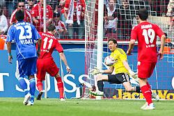 30.04.2010,  Rhein Energie Stadion, Koeln, GER, 1.FBL, FC Koeln vs Bayer 04 Leverkusen, 31. Spieltag, im Bild: Milivoje Novakovic (Koeln #11) (L) trifft zum 1:0 gegne Rene Adler (Leverkusen #1) (R)  EXPA Pictures © 2011, PhotoCredit: EXPA/ nph/  Mueller       ****** out of GER / SWE / CRO  / BEL ******