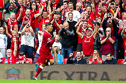 Roberto Firmino of Liverpool celebrates after scoring his sides first goal  - Mandatory by-line: Matt McNulty/JMP - 27/08/2017 - FOOTBALL - Anfield - Liverpool, England - Liverpool v Arsenal - Premier League