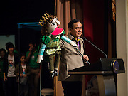 10 JANUARY 2015 - BANGKOK, THAILAND: General PRAYUTH CHAN-OCHA, the Prime Minister of Thailand, holds a puppet while he talks to children about being good citizens during National Children's Day celebrations at Government House in Bangkok. National Children's Day falls on the second Saturday of the year. Thai government agencies sponsor child friendly events and the military usually opens army bases to children, who come to play on tanks and artillery pieces. This year Thai Prime Minister General Prayuth Chan-ocha, hosted several events at Government House, the Prime Minister's office.    PHOTO BY JACK KURTZ