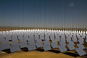 Site de la tour PS10 de la centrale solaire de Sanlucar la Mayor, pres de Seville, Espagne, le 29 Avril 2008. La centrale solaire, la premiere centrale commerciale au monde, appartenant a la societe espagnole Solucar (Abengoa), peut produire de l'electricte pour 6000 habitations. Solucar (Abengoa) projete de construire un total de 9 nouvelles tours dans les 7 ans qui viennent, afin de fournir 180 000 habitations en electricite. Photographe: Markel Redondo/Fedephoto pour Greenpeace...The PS10 solar tower plant sits at Sanlucar la Mayor outside Seville on April 29, 2008 in Seville, Spain. The solar tower plant, the first commercial solar tower in the world, by the Spanish company Solucar (Abengoa), can provide electricity for up to 6,000 homes. Solucar (Abengoa) plans to build a total of 9 solar towers over the next 7 years to provide electricity for an estimated 180,000 homes. Photographer: Markel Redondo/Fedephoto for Greenpeace.