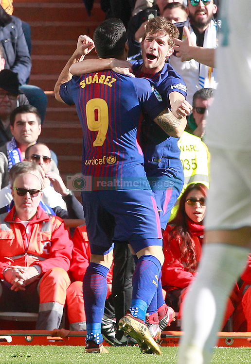 FC Barcelona's Luis Suarez (l) and Sergi Roberto celebrate goal during La Liga match. Madrid, Spain, on December 23, 2017. Photo by Acero/AlterPhotos/ABACAPRESS.COM