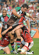 Twickenham, GREAT BRITAIN, Harlequins', Nick EASTER tackled by  Saracens defenders, during the Guinness premiership match Harlequins vs Saracens  at The Stoop Stadium, Surrey on Sat. 19.09.2009.  [Photo. Peter Spurrier/Intersport-images]