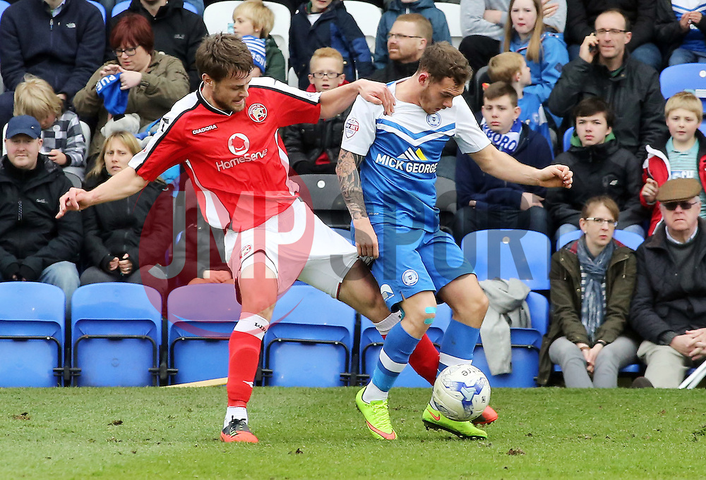 Peterborough United's Jon Taylor battles with Walsall's Andy Taylor - Photo mandatory by-line: Joe Dent/JMP - Mobile: 07966 386802 - 06/04/2015 - SPORT - Football - Peterborough - ABAX Stadium - Peterborough United v Walsall - Sky Bet League One