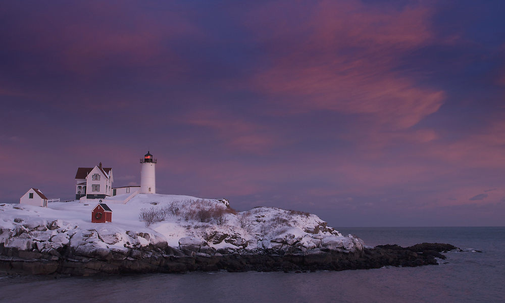 Nubble Light in York, Maine, was first illuminated in 1879 and still lights the way for mariners today. Each December the lighthouse and buildings are decorated with lights to celebrate the Christmas season. Its fourth-order Fresnel lens dates to 1891. The light was automated in 1987.