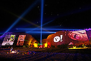 Yahoo! projects images from their Time Capsule Project onto the cliffs at Jemez Pueblo Reservation on October 25, 2006 in New Mexico. The 18 hour live event spanned the evenings of October 25, 26, and 27th and featured the projection of giant digital images of Time Capsule submissions onto an ancient red rock cliff on the reservation. Each night opened with traditional dancing and music by the people of Jemez Pueblo, set in front of the immense projections and lighting that could be seen for miles through the desert.  (For Yahoo!)