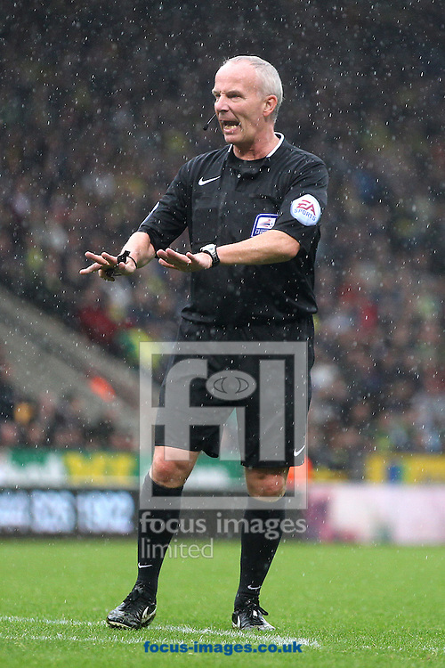 Referee Philip Gibbs during the Sky Bet Championship match at Carrow Road, Norwich<br /> Picture by Paul Chesterton/Focus Images Ltd +44 7904 640267<br /> 04/10/2014