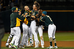 OAKLAND, CA - JULY 19:  Josh Reddick #22 of the Oakland Athletics is congratulated by teammates after hitting a walk off single against the Houston Astros during the tenth inning at the Oakland Coliseum on July 19, 2016 in Oakland, California. The Oakland Athletics defeated the Houston Astros 4-3 in 10 innings. (Photo by Jason O. Watson/Getty Images) *** Local Caption *** Josh Reddick