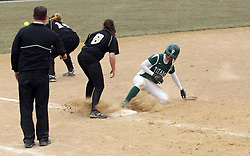30 March 2013:  Audra James arrives at 3rd base during an NCAA Division III women's softball game between the DePauw Tigers and the Illinois Wesleyan Titans in Bloomington IL