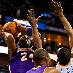 December 29, 2010; New Orleans, LA, USA; Los Angeles Lakers shooting guard Kobe Bryant (24) shoots over New Orleans Hornets center D.J. Mbenga (28) during the second quarter at the New Orleans Arena. The Lakers defeated the Hornets 103-88.  Mandatory Credit: Derick E. Hingle