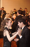 Christina Cook (left,) from Brookville dances with Enrique Rivera-Cerezo, a U.D. Student from San Juan at the 17th Artemis Center Gala, Saturday night.