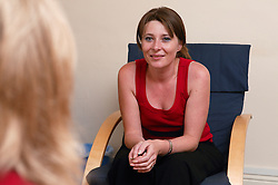 Young woman worker counselling a service user in a supported housing service,