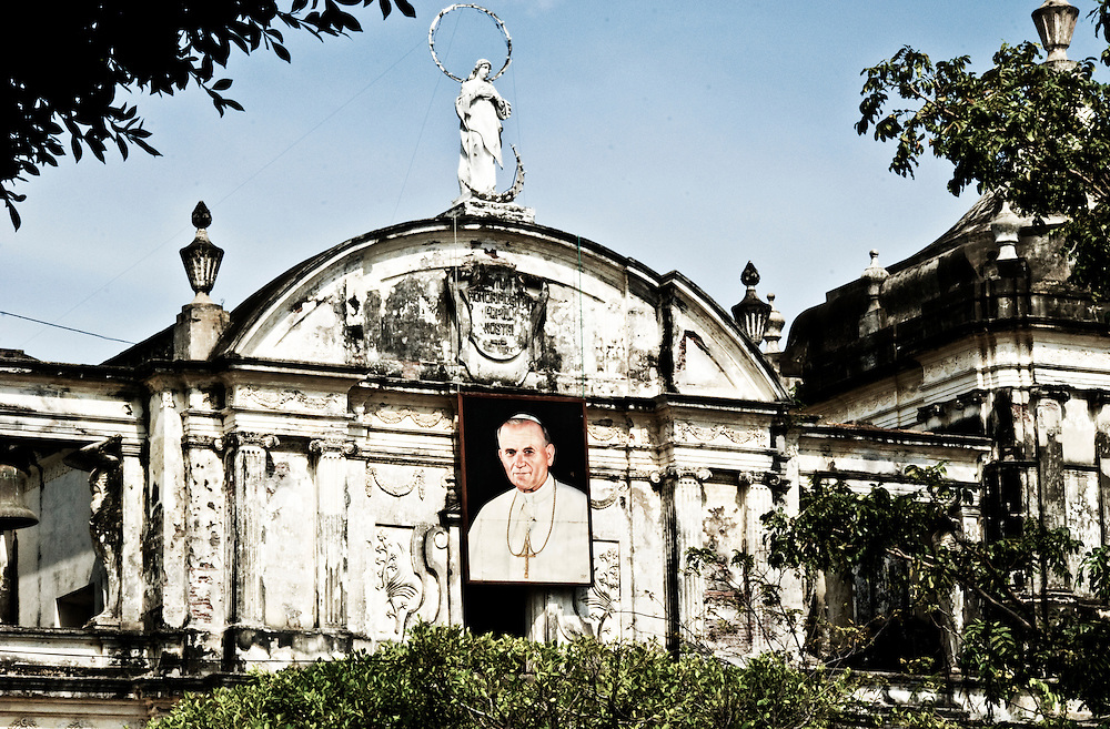 A portrait of the Pope hanging from the Leon Cathedral in honor of his upcoming visit to Nicaragua.