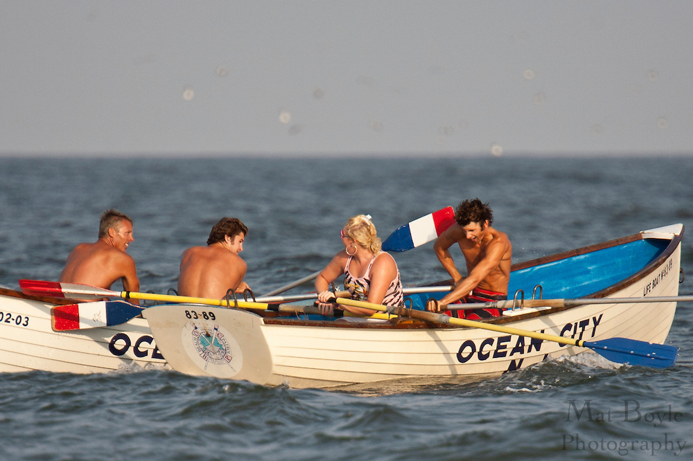Lifeguards from Ocean City NJ Beach Patrol compete in a city wide competition  pitting the four sections of lifeguards against each other in races involving swimming, paddle boards  and row boats.