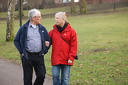 Couple walking in park. Cleared for Mental Health issues.