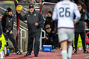 Craig Levein, manager of Heart of Midlothian returns the match ball to Marcus Godinho (#26) of Heart of Midlothian during the William Hill Scottish Cup quarter final replay match between Heart of Midlothian and Partick Thistle at Tynecastle Stadium, Gorgie, Edinburgh Scotland on 12 March 2019.