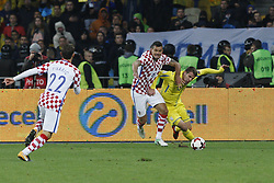 October 9, 2017 - Kiev, Ukraine - Artem Besedin (R) of Ukraine vies for the ball with Dejan Lovren (C) of Croatia during the 2018 FIFA World Cup qualifying soccer match between Ukraine and Croatia at the Olimpiyskyi stadium in Kiev, Ukraine, 09 October 2017  (Credit Image: © Str/NurPhoto via ZUMA Press)