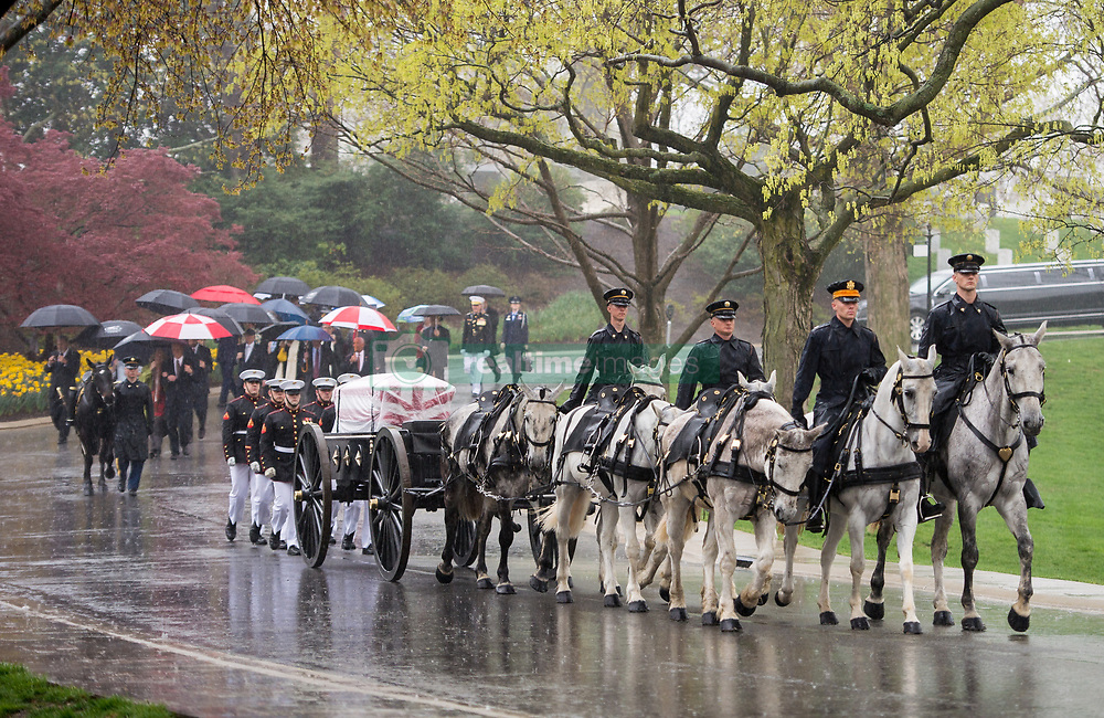 Apr 6, 2017 - Arlington, Virginia, U.S. - A horse drawn caisson carries former astronaut and U.S. Senator John Glenn to his final resting place during the interment ceremony at Arlington National Cemetery. Glenn was the first American to orbit Earth on Feb. 20, 1962, in a five-hour flight aboard the Friendship 7 spacecraft. In 1998, he broke another record by returning to space at the age of 77 on the Space Shuttle Discovery. Acting NASA Administrator Robert Lightfoot stated: 'Senator Glenn was more than an astronaut, he was the hero we needed in a rapidly changing world and an icon of our American spirit. We will never forget him, and future generations will continue to live out his legacy as we venture farther into the solar system. God speed, Senator Glenn. Our deepest gratitude, and everlasting respect and affection go with you.' (Credit Image: © Aubrey Gemignani/NASA/ZUMAPRESS.com)