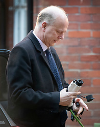 © Licensed to London News Pictures. 11/02/2019. Epsom, UK. Transport Secretary Chris Grayling unplugs his electric car as he leaves home this morning. Mr Grayling is under pressure after it was announced that a company given a contract for post-Brexit ferry services didn't have any ships. That contract has now been cancelled.  Photo credit: Peter Macdiarmid/LNP