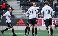 AMSTELVEEN -   Boris Burkhardt (Adam) scoort    ,tijdens de hoofdklasse hockeywedstrijd Amsterdam-HC Rotterdam (7-1).  rechts Billy Bakker (Adam) .  links Tijn Lissone (Adam) . COPYRIGHT KOEN SUYK